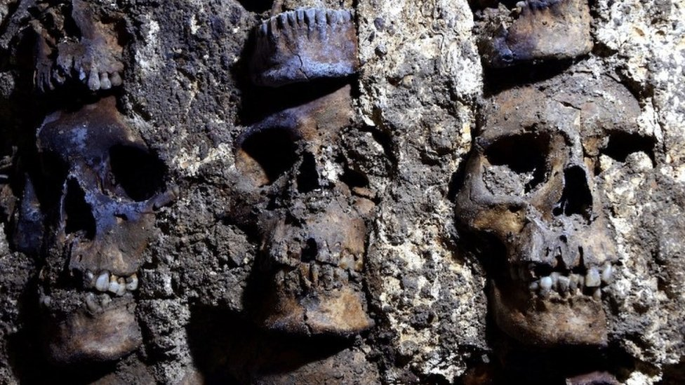 Facade of Aztec skull tower uncovered in Mexico