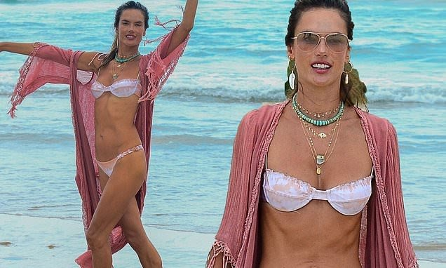 Alessandra Ambrosio shows off her toned figure in tiny white and pink two-piece as she soaks up the sun on one of Brazil's most beautiful beaches!!!