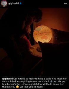 Zayn holding Khai in front of a glowing globe
